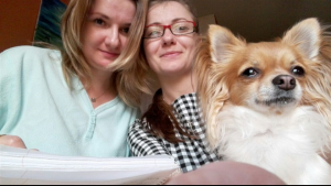 Martha with her sister, and her dog Figa